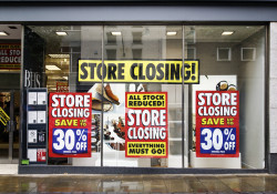 Swansea, UK: June 19, 2016: Front window of a department store that is closing down. British Home Stores is a British department store chain with branches mainly located in high street locations or shopping centres.